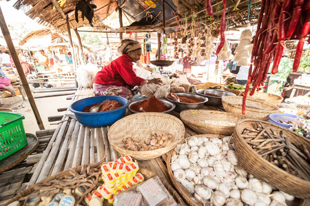 BAGAN, MYANMAR - JANUARY 16, 2014: Burmese women selling spices and local goods at traditional asian marketplace. Burma travel destinations