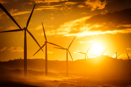 Wind turbine power generators silhouettes at ocean coastline at sunset. Alternative renewable energy production in Philippines Zdjęcie Seryjne