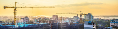 Aerial cityscape panorama view of building construction near the harbor at sunrise. Yangon, Myanmar (Burma) travel landscapes and destinations