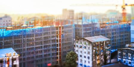 tilt and shift: Aerial cityscape panorama view of building construction at sunrise. Tilt shift effect. Yangon, Myanmar (Burma) travel landscapes and destinations