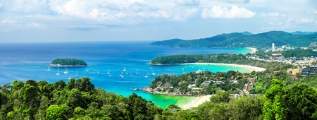 Tropical beach landscape panorama. Beautiful turquoise ocean waives with boats and sandy coastline from high view point. Kata and Karon beaches, Phuket, Thailand