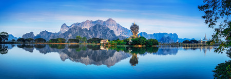 myanmar: Amazing Buddhist Kyauk Kalap Pagoda under evening sky. Hpa-An, Myanmar (Burma) travel landscapes and destinations. Five images panorama