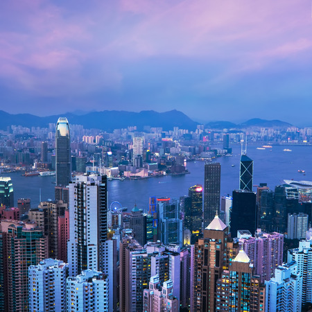 victoria harbor: Aerial view of Hong Kong skyline and Victoria Harbor at sunset. Travel destinations