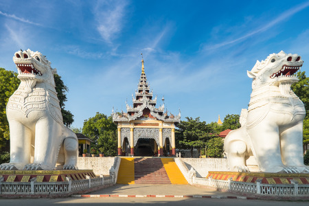 nat: Gigantic Bobyoki Nat guardian statues at central entrance gate to Mandalay Hill Pagoda complex. Amazing architecture of Buddhist Temples in Myanmar (Burma). Travel landscapes and destinations