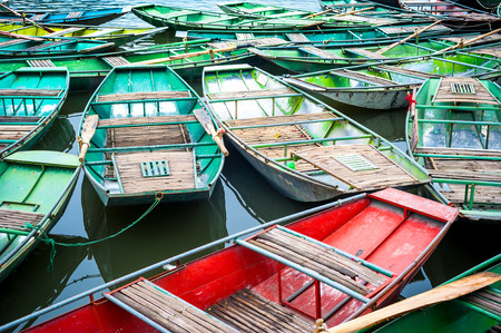 floating market: Vietnamese boats on the river early in the morning. Tam Coc, Ninh Binh,. Vietnam travel landscape and destinations Stock Photo