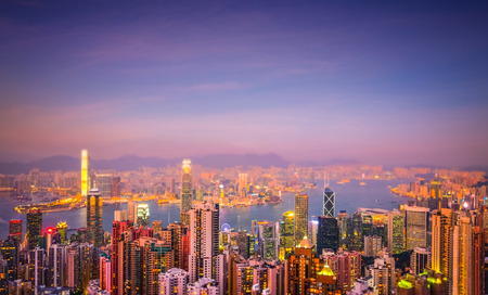 victoria harbor: Evening aerial view panorama of Hong Kong skyline and Victoria Harbor. Travel destinations. Tilt shift effect Stock Photo