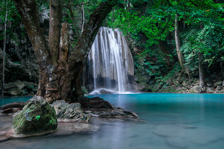erawan: Jangle landscape with flowing turquoise water of Erawan cascade waterfall at deep tropical rain forest. National Park Kanchanaburi, Thailand