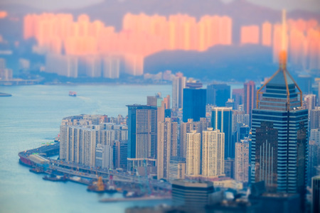 victoria harbor: Tilt shift aerial view panorama of Hong Kong skyline and Victoria Harbor at sunset. Travel destinations Stock Photo