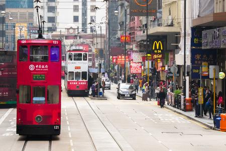 crowded street: HONG KONG - JAN 17, 2015: Hong Kong cityscape view with famous trams at Wan Chai