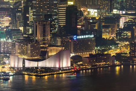 harbour: HONG KONG - Jan 14, 2015: Night aerial view panorama of Hong Kong skyline and Victoria Harbor. Travel destinations Editorial