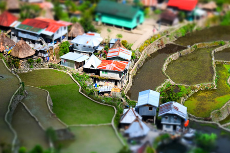 tilt and shift: Amazing tilt shift effect view of rice terraces fields and village houses in Ifugao province mountains. Banaue, Philippines UNESCO heritage Stock Photo
