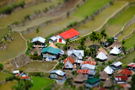 tilt view: Amazing tilt shift effect view of rice terraces fields and village houses in Ifugao province mountains. Banaue, Philippines UNESCO heritage Stock Photo