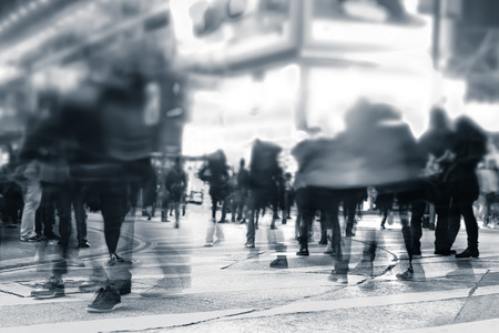 Blurred image of people moving in crowded night city street. Art toning abstract urban background. Hong Kong 스톡 콘텐츠