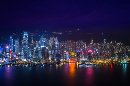 Night aerial view panorama of Hong Kong skyline and Victoria Harbor. Travel destinations