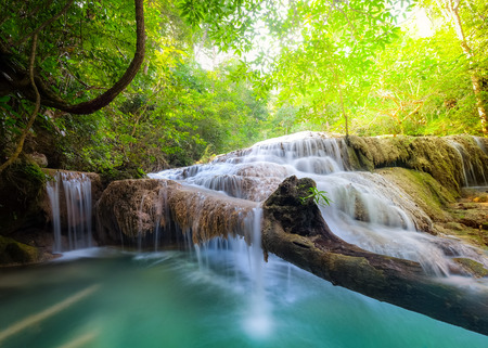 waterfall: Jangle landscape with flowing turquoise water of Erawan cascade waterfall at deep tropical rain forest. National Park Kanchanaburi, Thailand