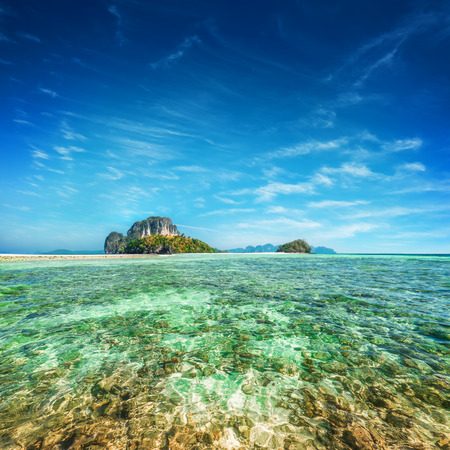 ocean water: Tropical ocean landscape with Koh Tup island at turquoise water under blue sky.Thailand, Krabi province, Ao Nang