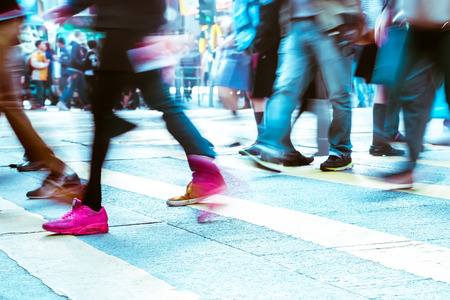 Blurred image of people moving in crowded city street. Art toning abstract urban background. Hong Kong Archivio Fotografico