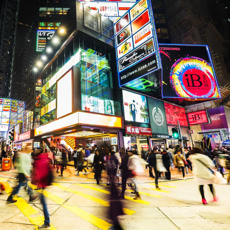 hong kong night: HONG KONG - JAN 16, 2015: Night view of big sopping mall with bright illuminated banners and people walking on crossroad at crowded city. Hong Kong Editorial