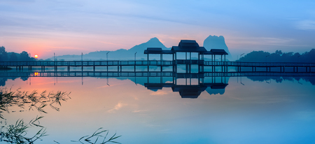 Amazing park landscape panorama at sunrise. Bridge and pavilion on lake at Hpa-An, Myanmar (Burma) travel landscapes and destinations