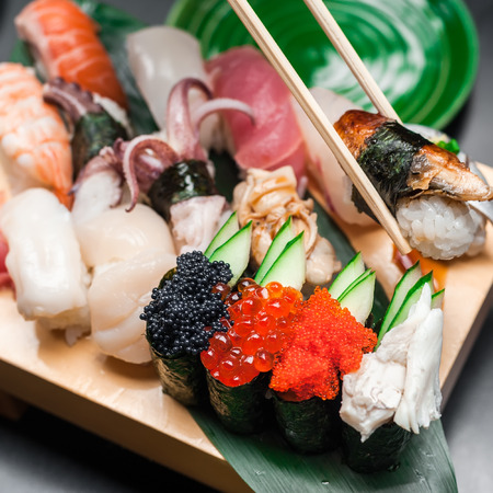 japanese food: Premium quality sushi rolls served in Japanese restaurant. Asian food background