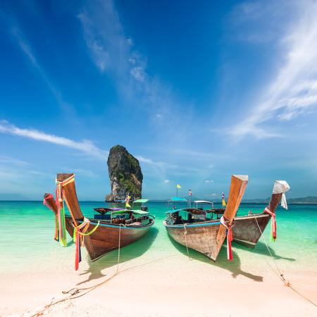 sailing boats: Thai traditional wooden boats with ribbon decoration at ocean shore near Koh Poda island. Thailand, Krabi province, Ao Nang Stock Photo