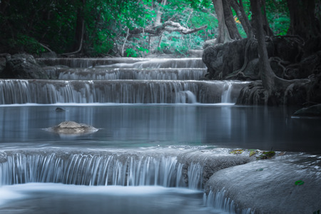 turquoise water: Jangle landscape with flowing turquoise water of Erawan cascade waterfall at deep tropical rain forest. National Park Kanchanaburi, Thailand