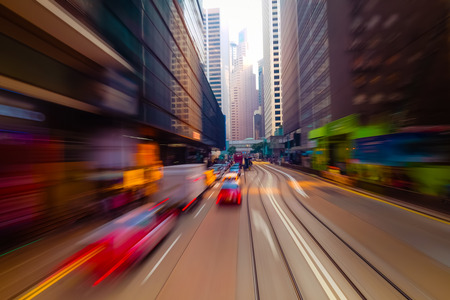 Moving through abstract modern city street with skyscrapers. Hong Kong. Abstract cityscape traffic background with taxi car driving. Watercolor painting effect, motion blur, art toning
