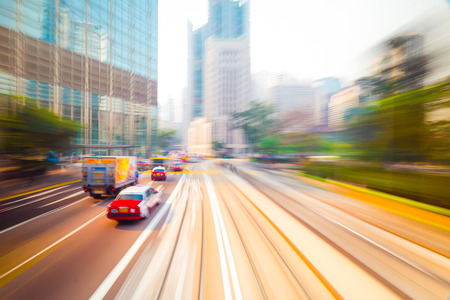 soft center: Moving through abstract modern city street with skyscrapers. Hong Kong. Abstract cityscape traffic background with taxi car driving. Watercolor painting effect, motion blur, art toning
