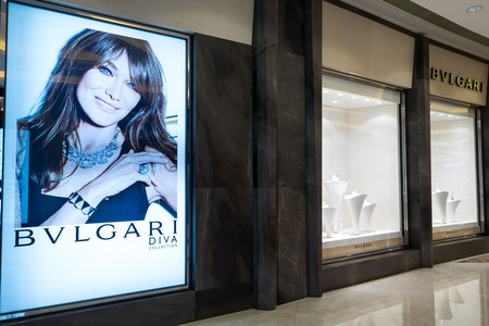 luxury goods: HONG KONG - 22 JAN, 2015: Bulgari fashion boutique display window. Italian jewelry and luxury goods brand produces and markets such product lines as jewelry, watches, fragrances and accessories