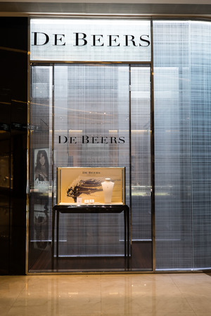 window display: HONG KONG - 23 JAN, 2015: De Beers fashion boutique display window. Company was founded in 1888 by British businessman Cecil Rhodes. Has a worldwide leading role in mining and trading diamonds