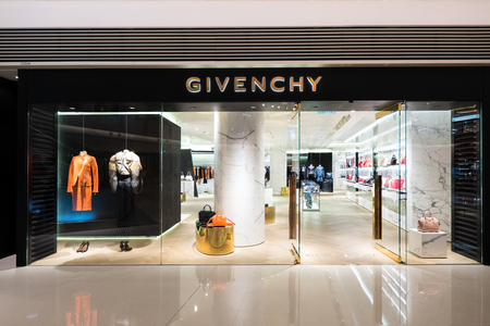 haute couture: HONG KONG - 22 JAN, 2015: Givenchy fashion boutique display window with mannequin in haute couture clothes and luxury accessories for exclusive shopping