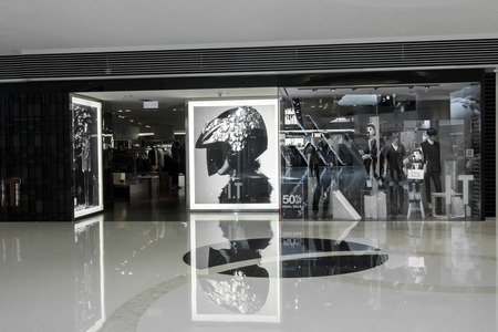 boutique: HONG KONG - 23 JAN, 2015: I.T company fashion boutique display window. Hong Kong  based, owns a number of local and expensive Japanese and European clothing, accessories brands. Editorial