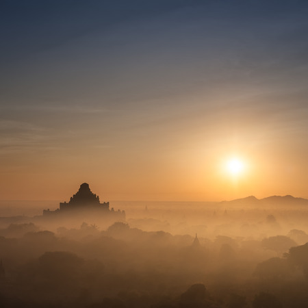 buddhist stupa: Amazing misty sunrise colors and silhouette of ancient Dhammayan Gyi Pagoda. Architecture of old Buddhist Temples at Bagan Kingdom, Myanmar (Burma). Travel landscapes and destinations