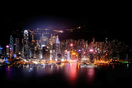 panorama: Night aerial view panorama of Hong Kong skyline and Victoria Harbor. Travel destinations