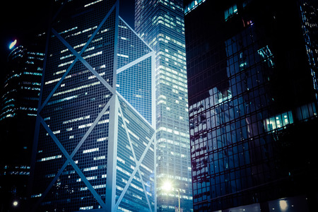 Abstract futuristic night cityscape with illuminated skyscrapers. Hong Kong Banco de Imagens