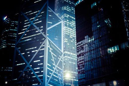 Abstract futuristic night cityscape with illuminated skyscrapers. Hong Kong Standard-Bild