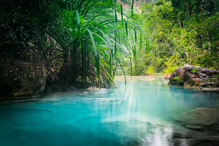 cascades: Jangle landscape with flowing turquoise water of Erawan cascade waterfall at deep tropical rain forest. National Park Kanchanaburi, Thailand