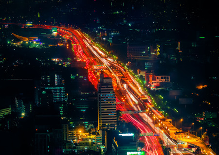city traffic: Futuristic night cityscape aerial view panorama with illuminated skyscrapers and city traffic across streets. Bangkok, Thailand Stock Photo