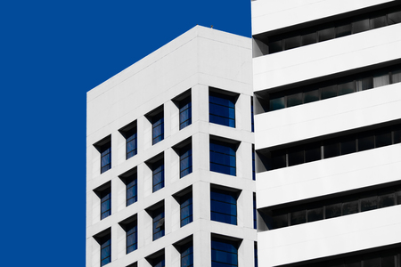 facade: Abstract minimal style architecture background. Modern building facade detail over blue sky Stock Photo