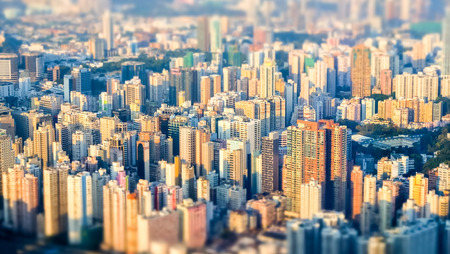 HONG KONG: Abstract futuristic cityscape with modern skyscrapers. Hong Kong aerial view evening panorama. Tilt shift effect