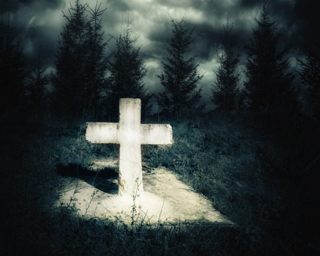 haunted: Dark night spooky landscape with abandoned grave and memory stone next haunted mysterious forest under dramatic sky. Evil and nightmare concept