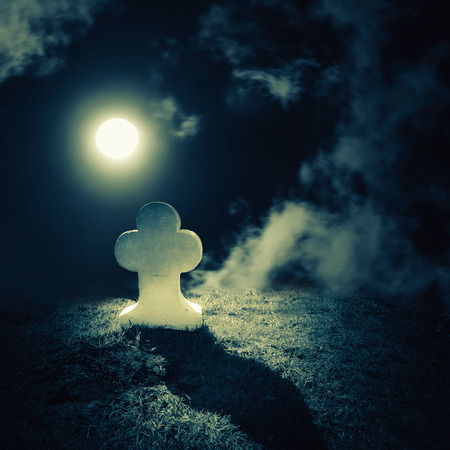 graves: Dark night spooky landscape with abandoned grave and memory stone on lonely haunted planet under full moon dramatic sky. Evil and nightmare concept Stock Photo