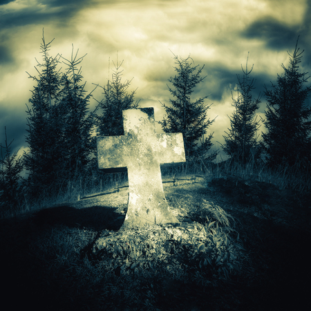 graves: Dark night spooky landscape with abandoned grave and memory stone next haunted mysterious forest under dramatic sky. Evil and nightmare concept