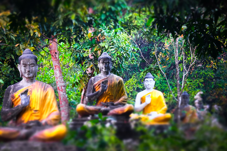 Tilt shift blur effect. Amazing view of lot Buddhas statues in Loumani Buddha Garden. Hpa-An, Myanmar (Burma) travel landscapes and destinations 스톡 콘텐츠