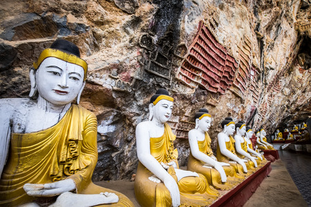 goon: Amazing view of lot Buddhas statues and religious carving on limestone rock in sacred Kaw Goon cave. Hpa-An, Myanmar (Burma) travel landscapes and destinations