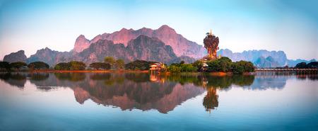 Amazing Buddhist Kyauk Kalap Pagoda under evening sky. Hpa-An, Myanmar (Burma) travel landscapes and destinations. Four images panorama