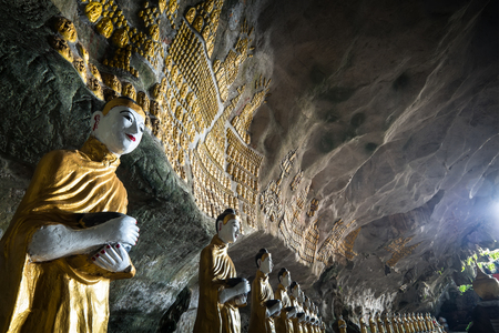 min: Amazing view of lot Buddhas statues and religious carving on limestone rock in sacred Sadan Sin Min cave. Hpa-An, Myanmar (Burma) travel landscapes and destinations