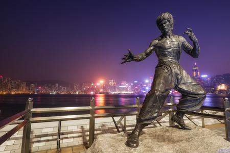 HONG KONG - JAN 15, 2015: Evening view of Bruce Lee statue in Tsim Sha Tsui, Hong Kong Avenue of Stars