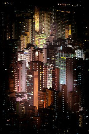 districts: Abstract futuristic night cityscape with illuminated skyscrapers. Hong Kong aerial view panorama Stock Photo