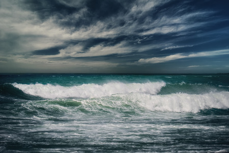breaking wave: Stormy ocean landscape with rainy clouds